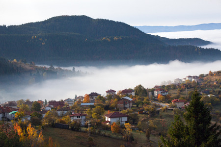 Autumn in the Rhodope Mountains, Bulgaria. Early morning. The mountain is covered with fog. Stok Fotoğraf