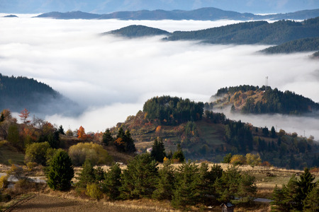 Autumn in the Rhodope Mountains, Bulgaria. Early morning. The mountain is covered with fog. Reklamní fotografie