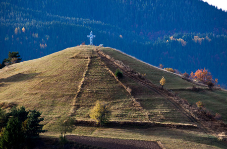 Autumn in the Rhodope Mountains, Bulgaria. Early morning. Christian chapel, Christian cross.