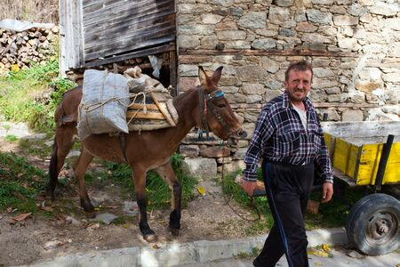 Rhodope Mountain, Bulgaria. 26 october 2016 The life of the people in the mountains is heavy. There are no roads to their fields and forests and they mainly use horses for transport. Redakční