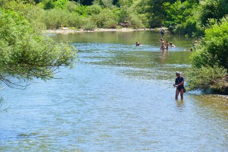 Sevlievo, Bulgaria. July 9, 2017. Hot summer day. People are looking for coolness in the waters of the mountain river Widima. Reklamní fotografie - 139324337