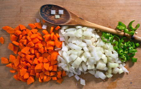 Sliced carrots, onions and peppers. Fresh vegetables. Cooking spices.