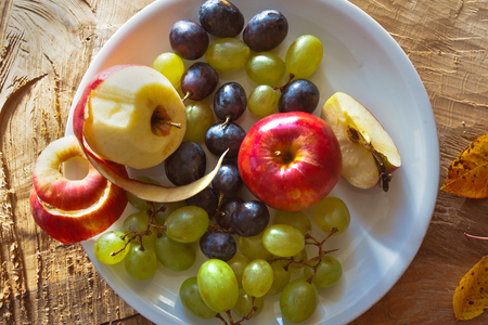Breakfast fresh fruit. Apples and grapes.