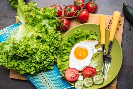 freshly cooked: freshly cooked breakfast with eggs, salad leaves, tomatos and cucumbers