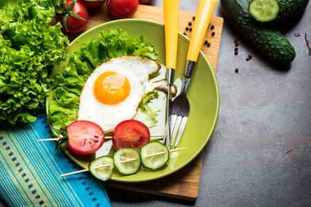 freshly cooked: Freshly cooked breakfast with eggs, cucumber, tomatos and salad leaves Stock Photo