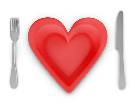 Fork, knife and heart-shaped plate