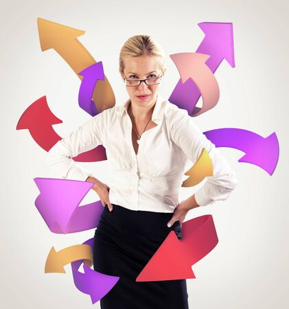 shootout: Arrows coming from a business woman Stock Photo