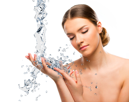 Beautiful woman close up with water splash
