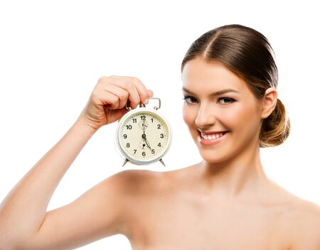 Beautiful woman with clock close up, smiling Stock Photo