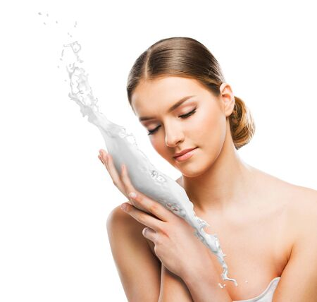 Beautiful woman with skin cream-milk splash Stock Photo