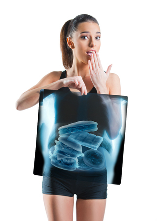 Fit, beautiful woman holding an x-ray of stomach Standard-Bild