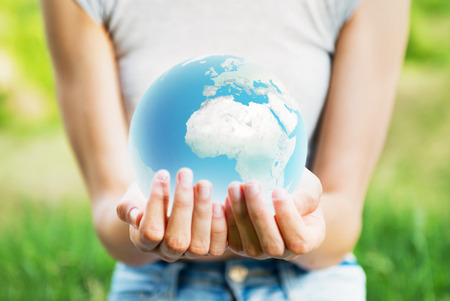Woman holding planet Earth in her hands Stock Photo
