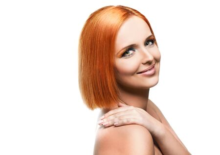 Beautiful young redhead woman isolated on white background Stock Photo