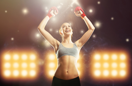 Young champion woman boxer celebrating victory