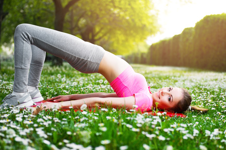 Fit young woman exercising outdoors, healthy lifestyle Stock Photo