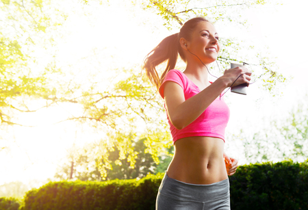 Fit young woman running  outdoors, healthy lifestyle Stock Photo