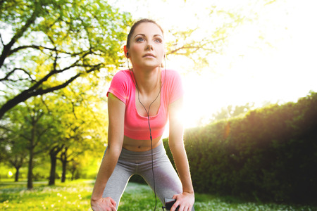 Fit young woman exercising outdoors, healthy lifestyle Standard-Bild