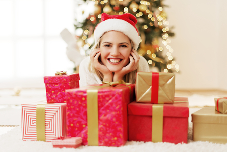 Young, beautiful woman with Christmas presents