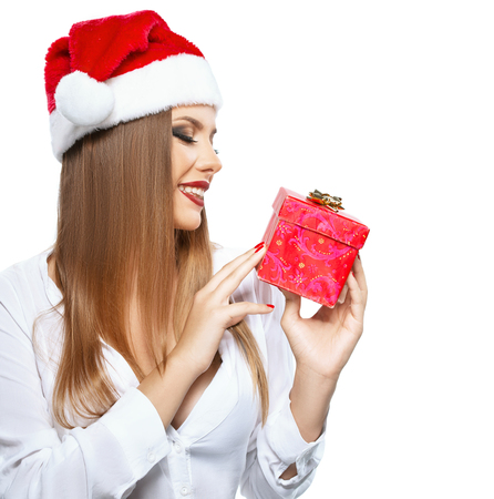 Beautiful woman with Santas hat holding a present on white background