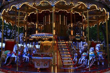 illuminated: Brightly illuminated traditional carousel