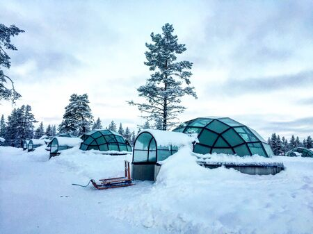 Glass igloos in winter season at Finland