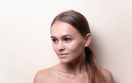 Closeup portrait of sexy white headed young woman with beautiful hazel eyes isolated on a light background