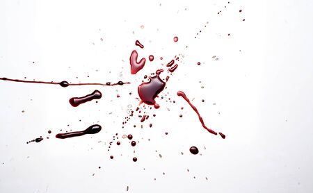 Blood on a white background. Drops and splashes of blood on a white background.