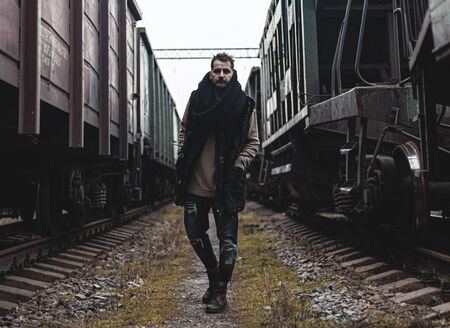 Portrait of a man in the middle of trains.