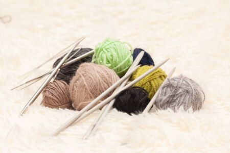Set for knitting yarn in a ball and knitting needles. Stock photo.