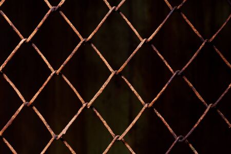 Rusty mesh background texture. Stock photo focus on a rusty sect of the fence.