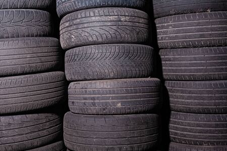 A lot of used out car tires in tire fitting. Stock photo many tires.