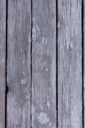 Old wooden background with peeling paint. Stock photo wood texture top view.