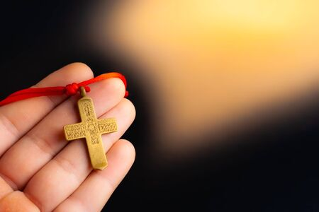 Cross in a man's hand. Stock photo hand with a cross of a believer.