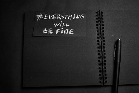 Everything will be fine. The inscription in chalk on a black paper background. Archivio Fotografico