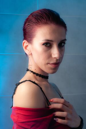 Red-haired girl close-up face portrait. Confident girl with makeup. Foto de archivo