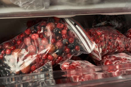 Freezing berries for the winter. Packaged frozen berries in plastic bags. In the freezer.