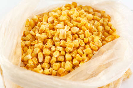 Frozen corn in a plastic bag. Reserve for the winter. Stock fotó