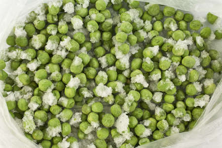 Frozen green peas in a plastic bag. Reserve for the winter.