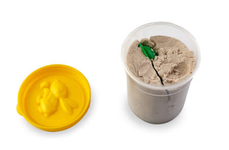 Kinetic sand packaging isolated on white background.