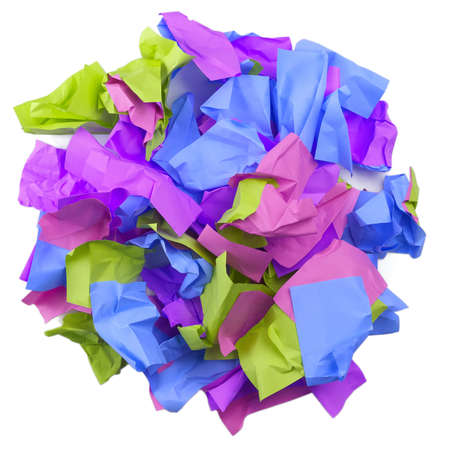 Used colorful stickers notes heap isolated on white. Top view. Stationery colored sticky notes.