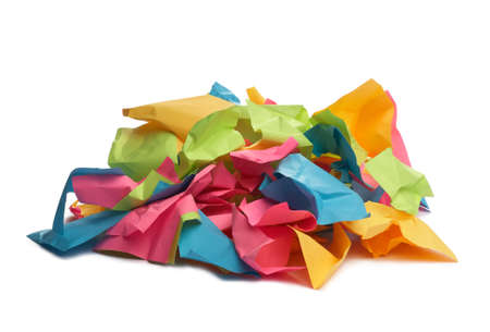 Used colorful stickers notes heap isolated on white. Side view. Stationery colored sticky notes.