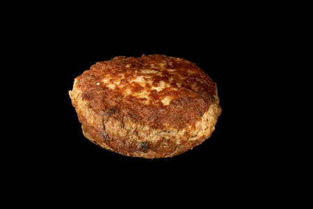 Fried meat cutlet isolated on black background burger ingredient.
