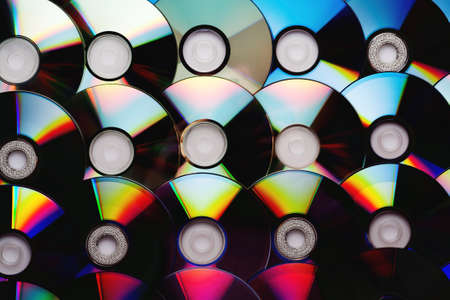 Compact CD discs collection. Background from a set of disks.