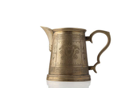 Antique coffee pot isolated on white background.