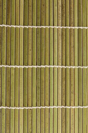 Bamboo background texture. Green mat for making sushi rolls. Standard-Bild