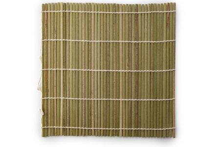 Green bamboo mat for making sushi rolls isolated on white background. Standard-Bild