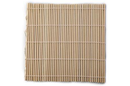 Bamboo mat for making sushi rolls isolated on white background. Standard-Bild