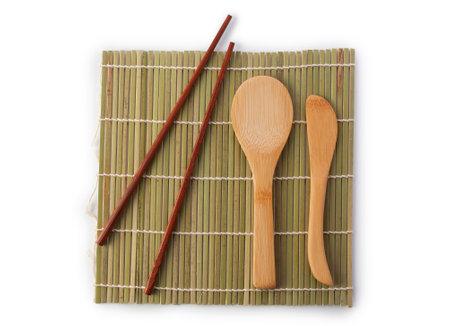Sushi set tableware bamboo chopsticks mat isolated on white background. Traditional oriental dish for making sushi rolls. Standard-Bild