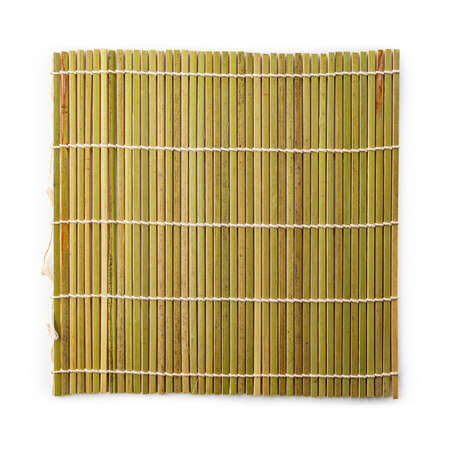 Sushi green bamboo mat isolated on white background. Standard-Bild