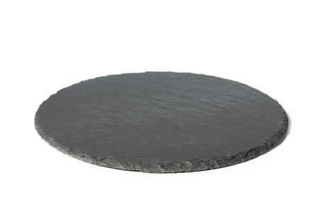 Round black empty slate board isolated on white background. Side view front.